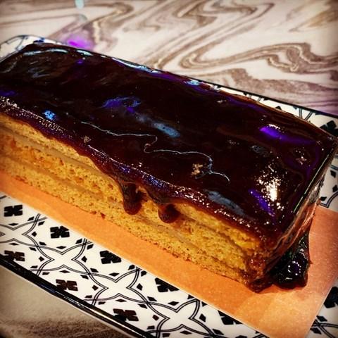 Soft gula melaka-infused moist cake layered with fresh gula melaka fudge.